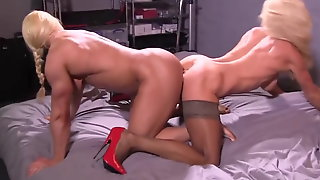 Two muscle women play with double dildo